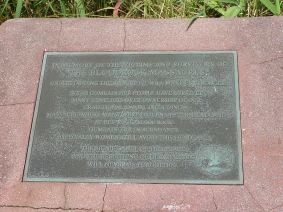 """Plaque at Red Rock in memory of the victims and survivors of """"The Bloodrock Massacres""""."""