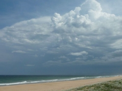 The view of the beach as we arrived with storm clouds that miraculously appeared (seemingly) from nowhere.