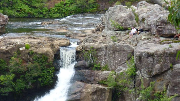 Man Sitting Near Falls