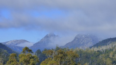 The cold mountains shrouded in cloud.