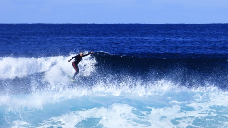 Dean Surfing At Dolphin Point