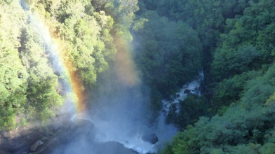 Twin rainbows in the water spray at Fitzroy Falls