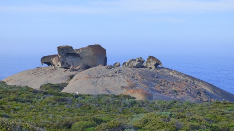 View of Remarkable Rocks from the view platform - there is a person standing under the rock arch on the far right.