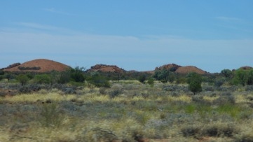 Rocks rise out of the plains.