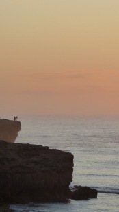 Two guys fishing off the cliffs