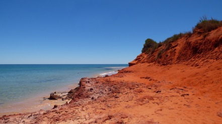 The red cliffs where the desert meets the sea